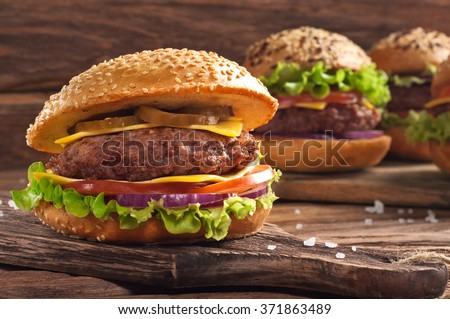 Homemade burger closeup on wooden background with copy space