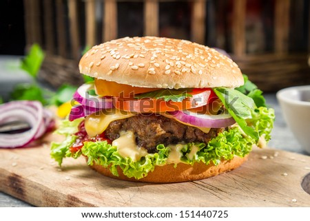 Homemade burger made �¢??�¢??from fresh vegetables and beef - stock photo
