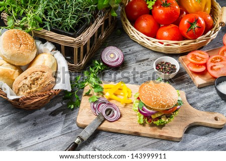 Homemade burger made from vegetables and meat - stock photo