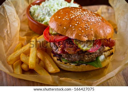 homemade burger with bacon - stock photo