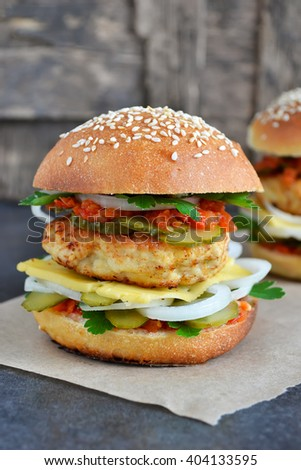 Homemade burger with cheese, meatballs and sauce - stock photo