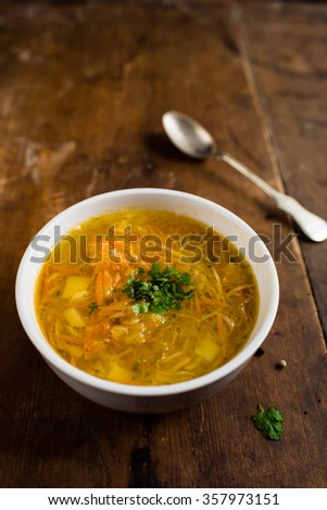 Homemade cabbage soup on a brown, vintage table - stock photo