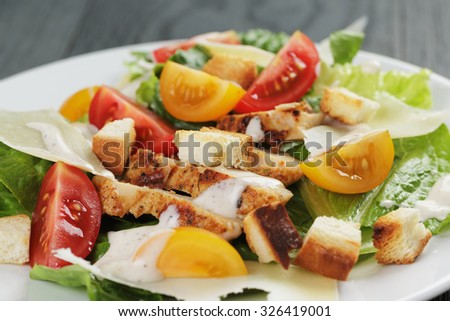 homemade caesar salad with chicken, shallow focus