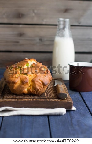 Homemade cake on wooden background. Place for text. Fruit cake with milk  - stock photo
