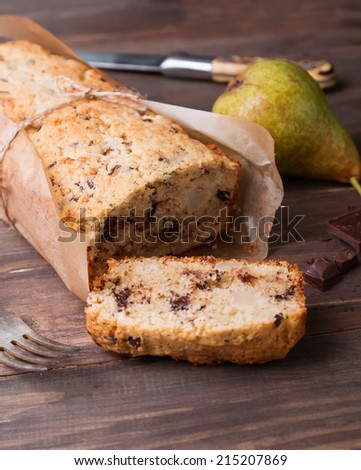 Homemade cake with pears and chocolate on the wooden table