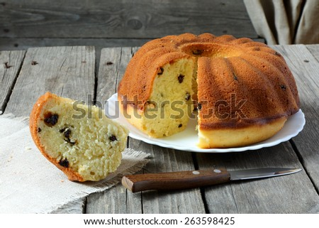 Homemade cake with raisins on a gray wooden table - stock photo