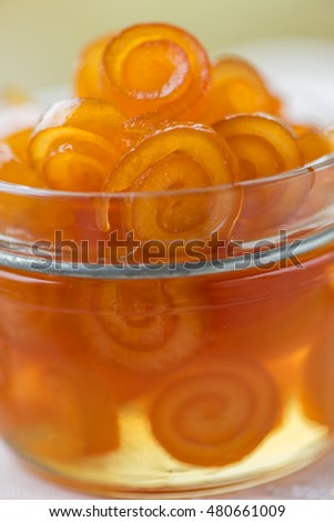 Homemade candied peels orange confiture in glass jar