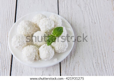 Homemade candies with coconut - stock photo