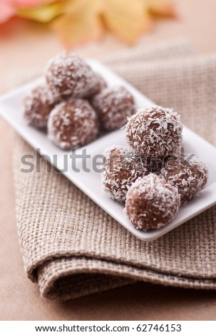 Homemade candies with coconut powder - stock photo