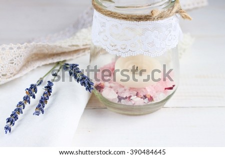 Homemade candle holder. Glass jar, herbal salt, lace, lavender twigs. - stock photo