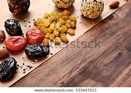homemade candy of dried apricots, raisins, nuts, prunes, sesame