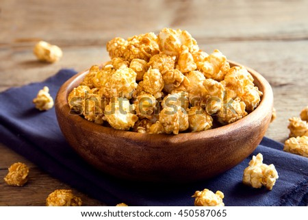 Homemade caramel popcorn in wooden bowl