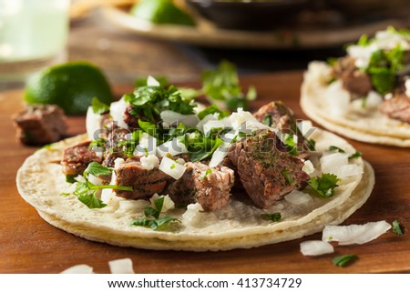 Homemade Carne Asada Street Tacos with Cheese Cilantro and Onion - stock photo