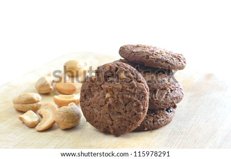 Homemade cashew nut and chocolate cookies on wood - stock photo