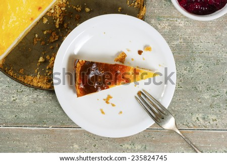 homemade cheesecake on rusty wood table - stock photo