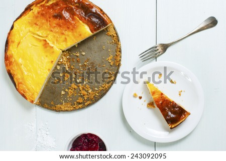 homemade cheesecake on white wood table - stock photo