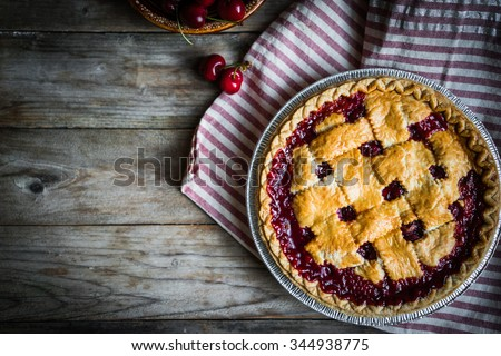 Homemade cherry pie on rustic background - stock photo