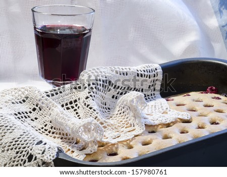 """Homemade cherry pie with a knitted cloth. From the series """"Homemade Cherry Pie"""" - stock photo"""