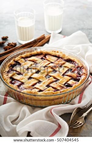 Homemade cherry pie with lattice on a distressed background