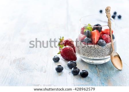 Homemade chia pudding with berry fruit in the glasses,selective focus and empty space
