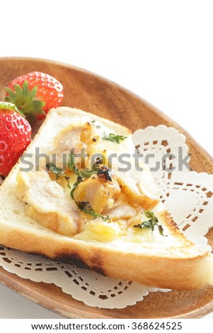 Homemade chicken and cheese open sandwich served with strawberry