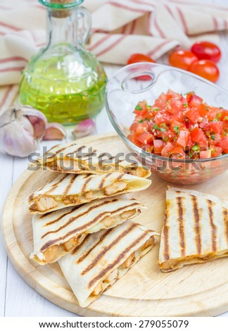 Homemade chicken and cheese quesadilla with salsa - stock photo
