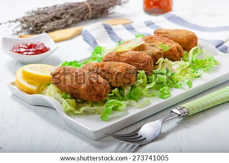 homemade chicken and vegetables croquettes on white tray - stock photo