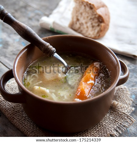 homemade chicken soup on table, natural light