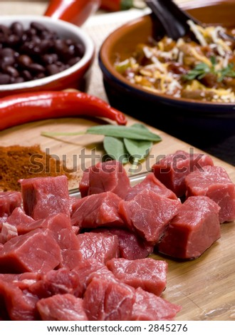 Homemade Chili with fresh vegetables herbs and spices. - stock photo