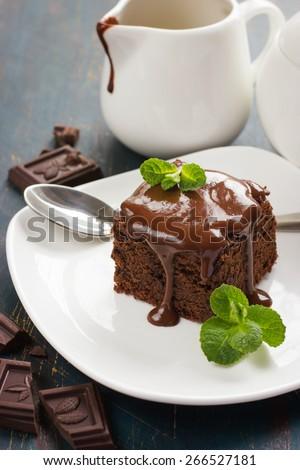 homemade chocolate brownies on dark background - stock photo