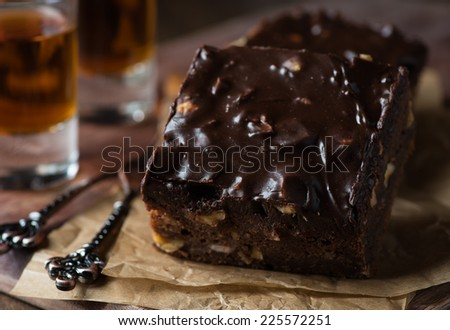 Homemade chocolate brownies with nuts and ganache, selective focus - stock photo