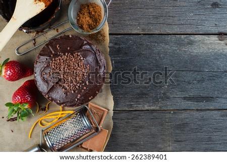 homemade chocolate cake recipe border background from above - stock photo