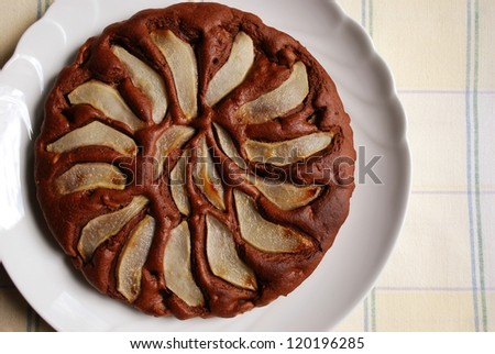 Homemade chocolate cake with sliced pears on the top - stock photo