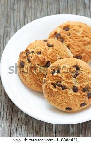Homemade  chocolate chip cookie on a white plate.