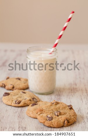 Homemade chocolate chip cookies with a glass of milk - stock photo
