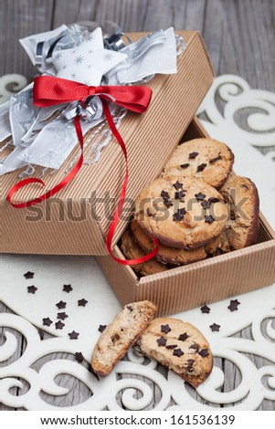 Homemade chocolate chip cookies with christmas decorations on a wooden background - stock photo