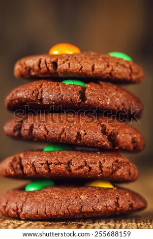 Homemade  chocolate cookies decorated with multi-colored candy drops - stock photo