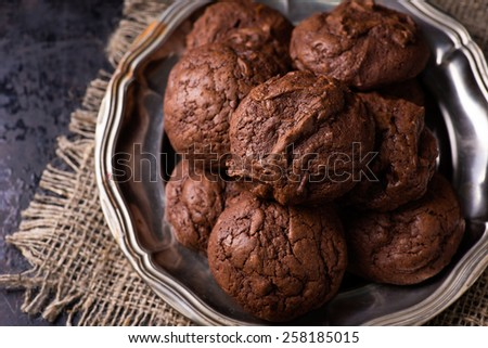 Homemade chocolate cookies on dark background, selective focus, top view - stock photo