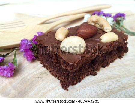 Homemade chocolate fudge brownie with mixed nut topping. ( Macadamias, almond, peanut, cashew nut ) - stock photo
