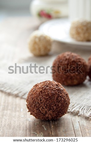 Homemade chocolate truffle with chocolate chips on the surface - stock photo