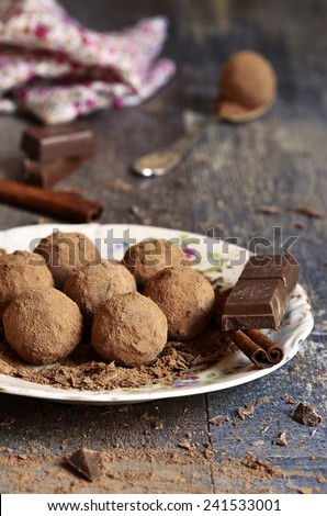 Homemade chocolate truffles on a plate. - stock photo