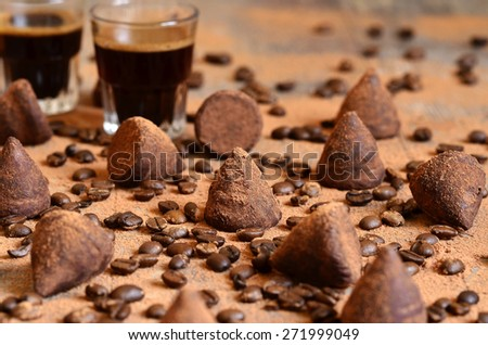 Homemade chocolate vanilla and coffee truffles with glass of coffee. - stock photo