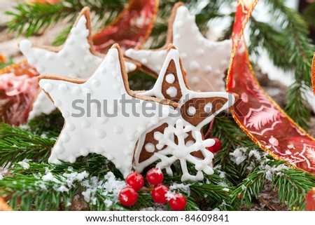 Homemade Christmas cookie stars with decoration - stock photo