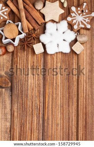 Homemade christmas cookies and spice  on wooden background - stock photo