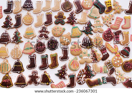 Homemade christmas cookies on white table. winter holiday food pattern - stock photo