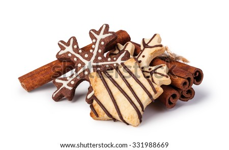 Homemade christmas cookies on wooden table, isolated on white background - stock photo