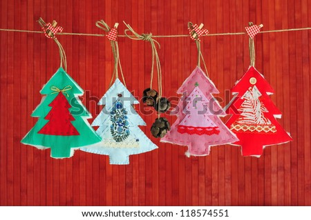 Homemade Christmas decoration over wooden red background - stock photo