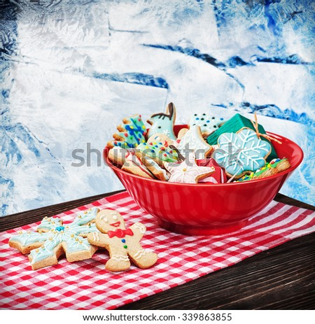 homemade Christmas gingerbread cookies. focus on gingerbread in the foreground - stock photo