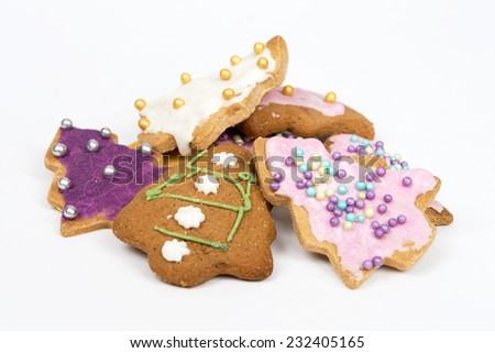 Homemade christmas gingerbread cookies on a white background - stock photo