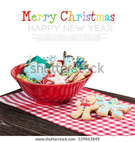homemade Christmas gingerbread cookies on a white background isolation. focus on gingerbread in the foreground. Text example and remove - stock photo